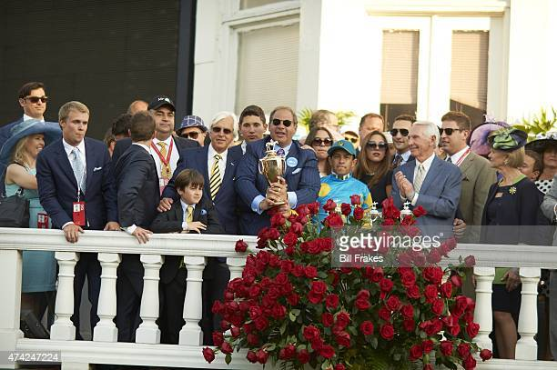 141st Kentucky Derby Ahmed Zayat owner of American Pharoah victorious with trainer Bob Baffert and jockey Victor Espinoza while holding trophy in...