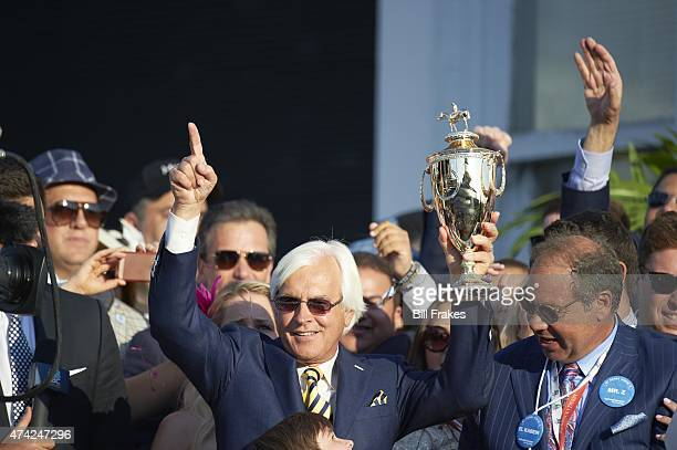 141st Kentucky Derby Bob Baffert trainer for American Pharoah and owner Ahmed Zayat victorious with trophy in Winner's Circle after race at Churchill...