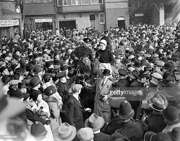 Horse Racing 19th March 1937 The horse Royal Mail ridden by jocky EWilliams is led in through a great crowd after winning the Grand National at...