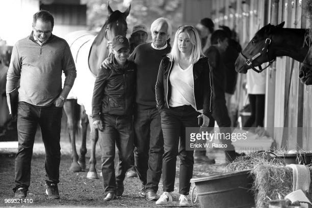 2018 Belmont Stakes Preview Casual portrait of horse trainer Bob Baffert his wife Jill BAffert and jockey Mike Smith in stable during morning...
