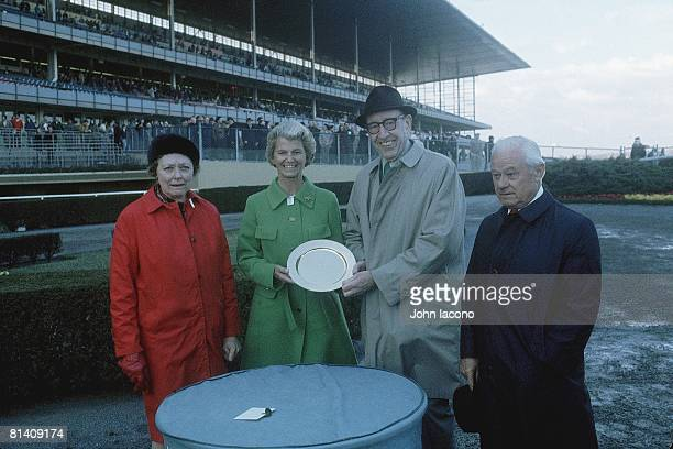 Horse Racing Bay Shore Stakes Secretariat owner Helen Chenery Tweedy victorious with trophy and trainer Lucien Laurin at Aqueduct Raceway Jamaica NY...