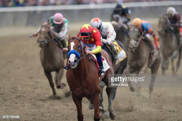 Belmont Stakes Mike Smith in action aboard Justify leading during race at Belmont Park Elmont NY CREDIT Simon Bruty