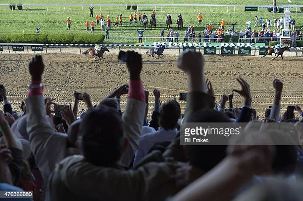 Belmont Stakes Victor Espinoza in action crossing finish line to win race aboard American Pharoah at Belmont Park American Pharoah wins Triple Crown...