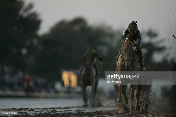 Horse Racing Breeders Cup Classic Robby Albarado in action winning race aboard Curlin at Monmouth Park Racetrack Mud weather Oceanport NJ