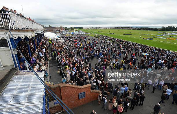 Horse racing enthusiasts at Ayr racecourse on September 21 2013 in Ayr Scotland