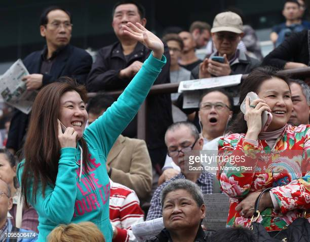 Horse racing fans cheers during Chinese New Year Race Day at Sha Tin racecourse in Sha Tin 21FEB15