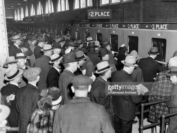 Horse racing fans gather at Belmont Park Race Track mutual windows on Long Island to place their bets Elmont New York May 13 1944