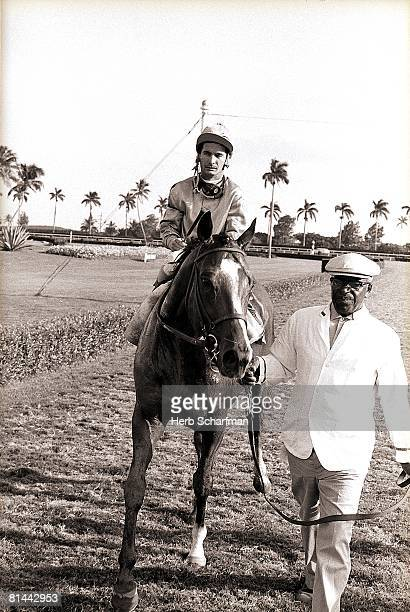 Horse Racing Florida Derby Bill Shoemaker victorious aboard Northern Dancer after winning race at Gulfstream Park Hallandale FL 4/4/1964