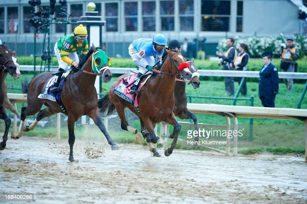 Kentucky Derby Mike Smith aboard Palace Malice in action vs Kevin Krigger aboard Goldencents during race at Churchill Downs Louisville KY CREDIT...