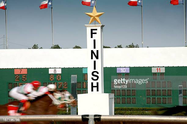 Horse racing. Race track finish line.
