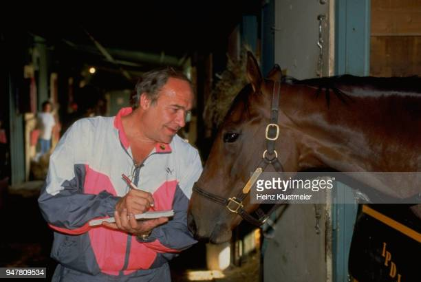 Santa Anita Derby Preview Portrait of SI writer William Nack posing with the horse Best Pal during photo shoot in stable at Santa Anita Race Track...