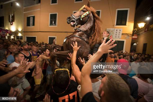 A horse rears in the crowd during the traditional San Juan festival in the town of Ciutadella on the Balearic Island of Menorca in the night before...