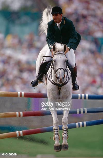 A horse ridden by the Brazilian equestrian Alvaro Alfonso de Miranda Neto jumps a fence during an event at the Olympic Games