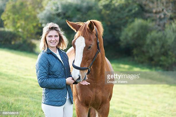 Horse rider and horse in countryside.