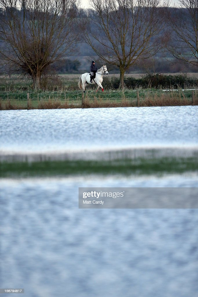 A horse rider passes flooded fields and roads close to the village of North Curry on November 21, 2012 near Taunton, England. Heavy rain overnight has brought widespread disruption to many parts of the UK particularly in the Somerset and Wiltshire and weather forecasters have warned of more wet and windy weather to come.