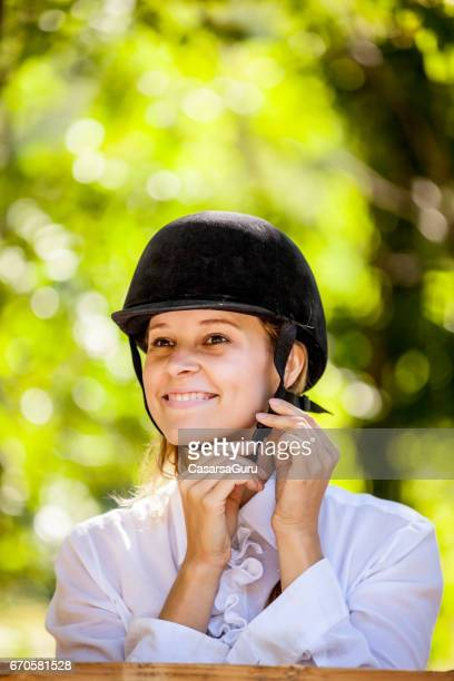 horse rider shoud wearing helmet for head protection - riding hat stock pictures, royalty-free photos & images