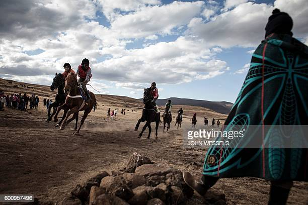 Horse riders cross the finish line on July 16 2016 in Semonkong Horseracing in the mountain kingdom of Lesotho is not like at Ascot or Longchamp but...