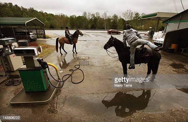 Horse riders prepare to depart after a break at a gas station during the Owsley County Saddle Club trail ride on April 21 2012 in Booneville Kentucky...
