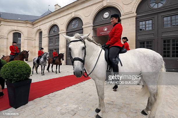 Horse riders welcome guests at the Domaine de Chantilly on June 15 during the inauguration of the renovated Musee du Cheval in Chantilly north of...