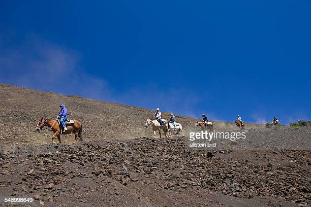 Horse Riding at Crater of Haleakala Volcano Maui Hawaii USA