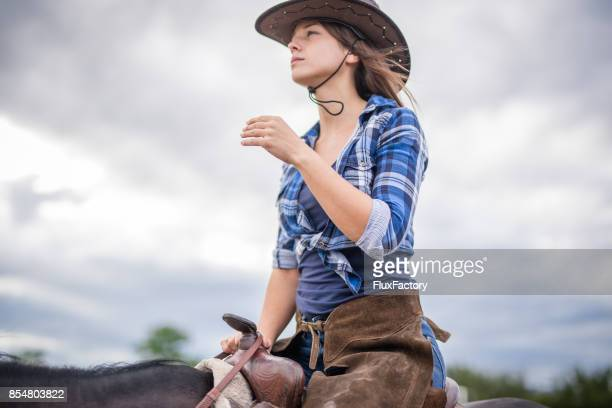 horse riding is her pasion - brown hat stock photos and pictures