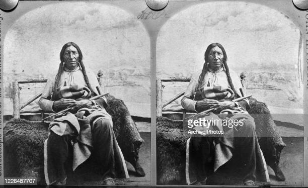 Horse Roads, a Sioux chief with a peace pipe, USA, circa 1870. From 'Stereoscopic Views of the Yellowstone Country'.