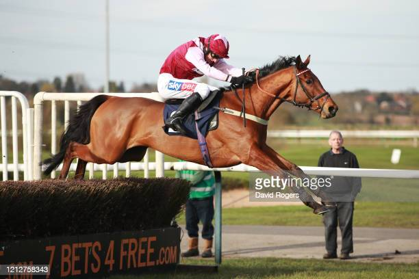 Horse Shantou Vow and jockey D A Jacob jumps over the final hurdle to win the MansionBet At Southwell Novices' Hurdle race during the Winter...