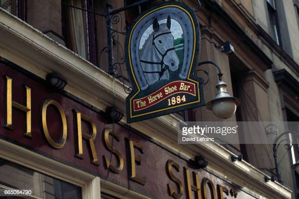 Horse shoe bar sign outside one of Glasgow's most famous watering holes Images and captions taken from the book La Magie du Whisky