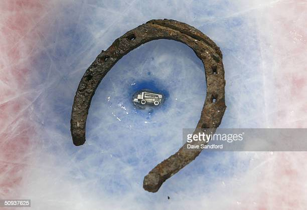 A horse shoe is placed around a diecast Zamboni that was placed under the ice before the game and before the Tampa Bay Lightning defeated the Calgary...