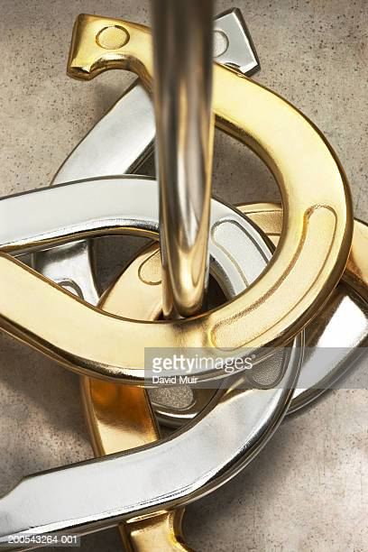 horse shoes around pole, close-up, elevated view - horseshoe stock pictures, royalty-free photos & images