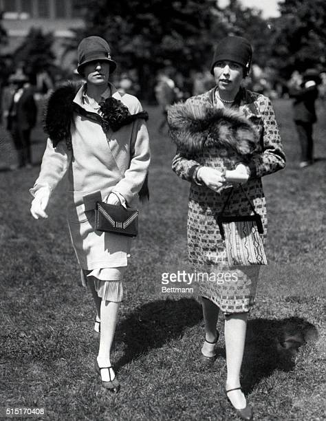 Horse show society attendnats 1920'S The women are impeccably dressed with fox stoles draped on their shoulders Undated photograph