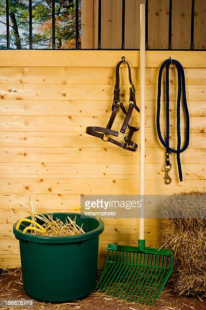 horse stall with muck bucket and stable fork - cmannphoto stock pictures, royalty-free photos & images
