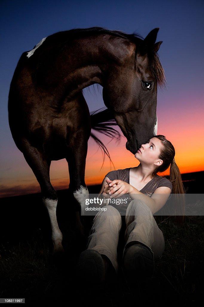 Horse Standing Guard Over His Girl : Bildbanksbilder