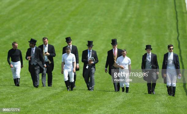 Horse trainer Aidan O'Brien walks with his team down the track to the finish line during the Investec Epsom Derby Day at Epsom Downs on June 2 2018...