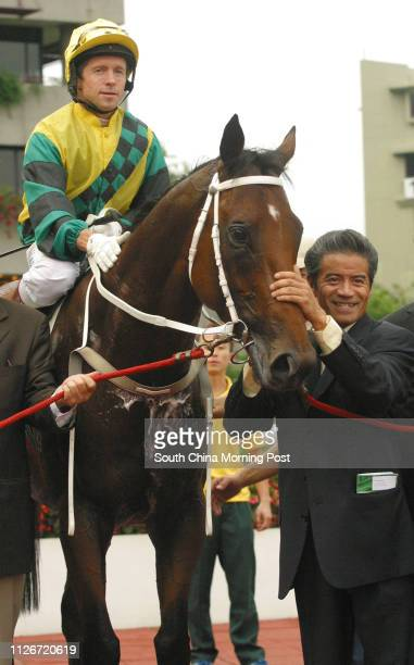 Horse trainer Anthony Cruz patting winning horse Hidden Dragon which was earlier ridden by Felix Coetzee won the Race 10 at Sha Tin Racecourse 18 May...