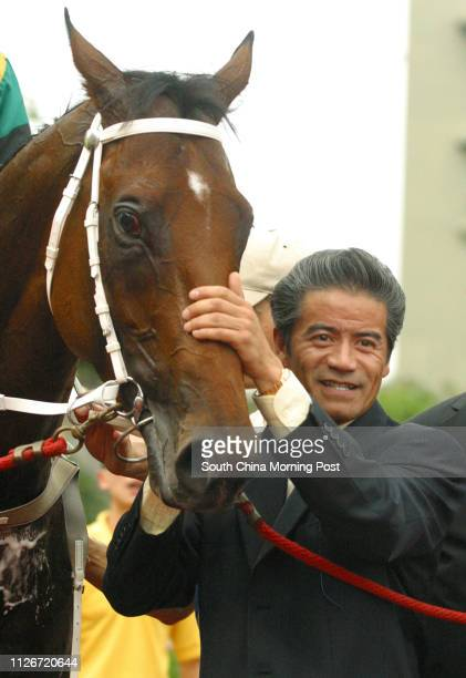 Horse trainer Anthony Cruz patting winning horse Hidden Dragon which won the Race 10 at Sha Tin Racecourse 18 May 2003