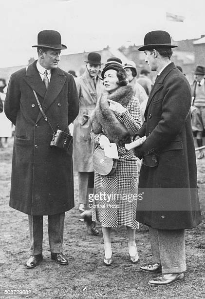Horse trainer Captain Cecil BoydRochford and dancer Adele Astaire the wife of Lord Charles Cavendish having a discussion in the paddock at Aintree...