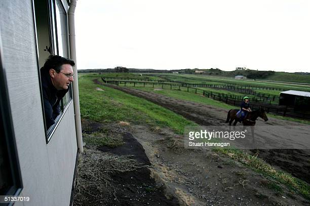 Horse trainer Lee Freedman watches during morning trackwork at his property September 23 2004 in Rye Australia With the Spring Carnival season...