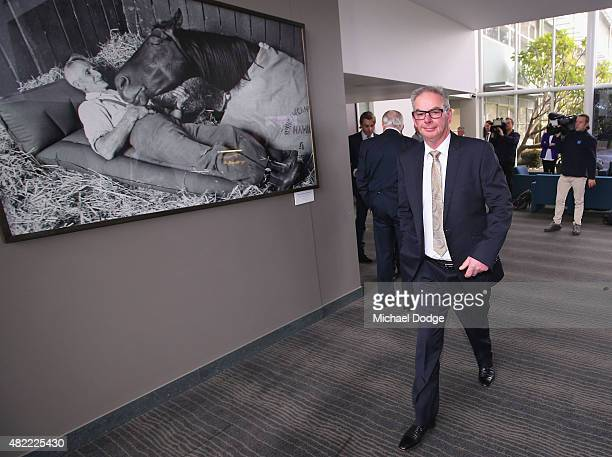 Horse trainer Lee Hope leaves the hearing room during the Racing Victoria hearing at Racing Victoria HQ on July 29 2015 in Melbourne Australia Racing...