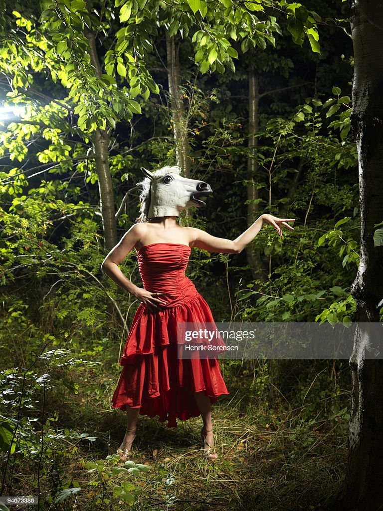 Horse Woman Standing In Red Dress In Forest Stock Photo