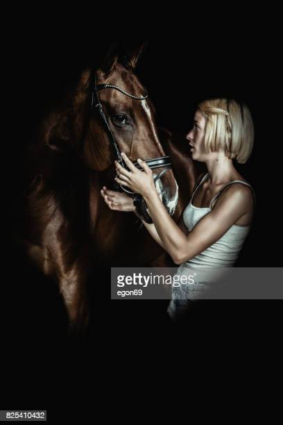 horse & women - restraint muzzle stock photos and pictures