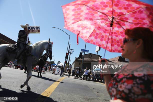 A horseback rider carries a sign for US Senate candidate Kevin de Leon during the 72nd annual East LA Mexican Independence Day Parade on September 16...