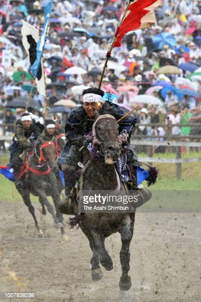 Horseback riders in full-body armor compete in the 'Kacchu keiba' horse racing, during the 'Soma Nomaoi Festival' on July 29 ,2018 in Minamisoma,...