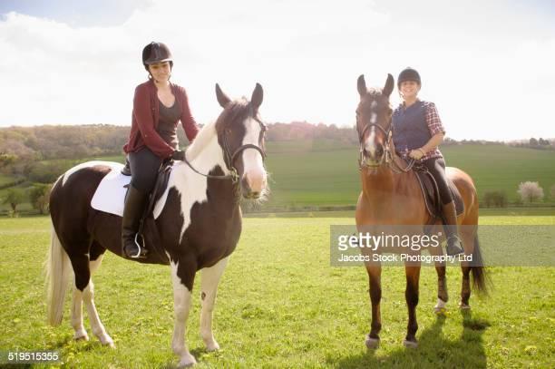 Horseback riders in rural field