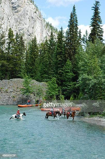 Horseback riding across the Bow River, Banff, Alberta Canada