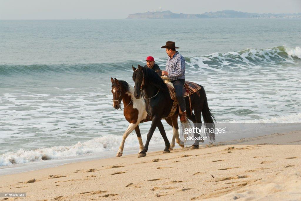 Horseback Riding at the Pacific Ocean : Stock Photo