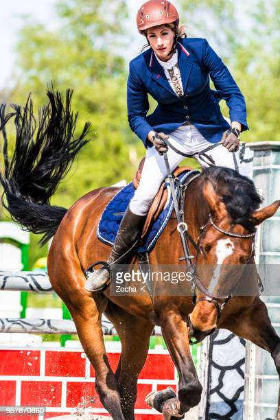horseback riding - horse and female rider - male feet on face stock photos and pictures