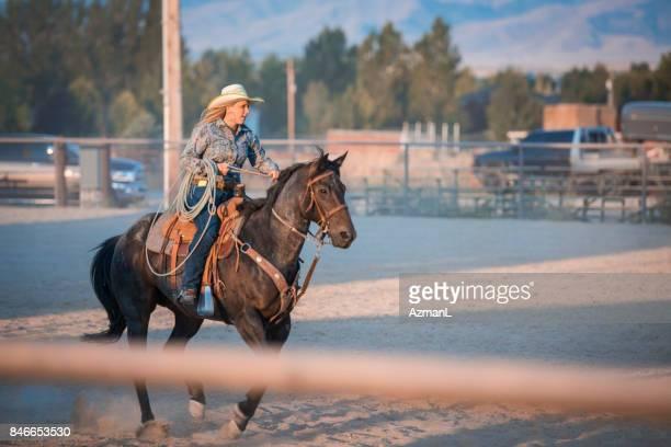 Horseback riding in rodeo arena