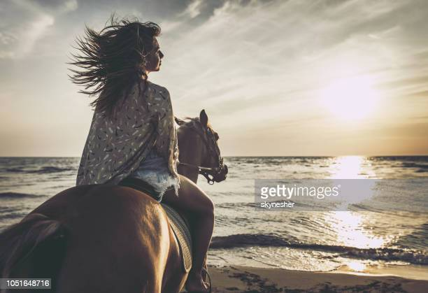 horseback riding on the beach! - recreational horseback riding stock pictures, royalty-free photos & images