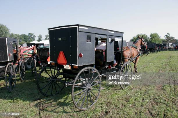 A horsedrawn Amish buggy at a farm auction in Shipshewana